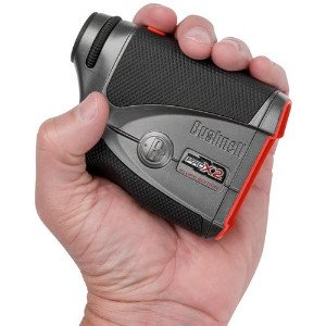 A hand holding the Bushnell Pro X2 Slope Edition