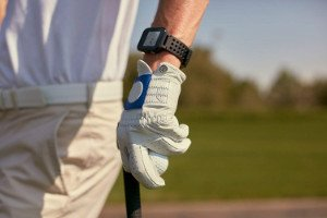 Person wearing Garmin S20 GPS Watch for golf