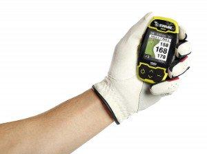 hand holding Swami 5000 golf rangefinder