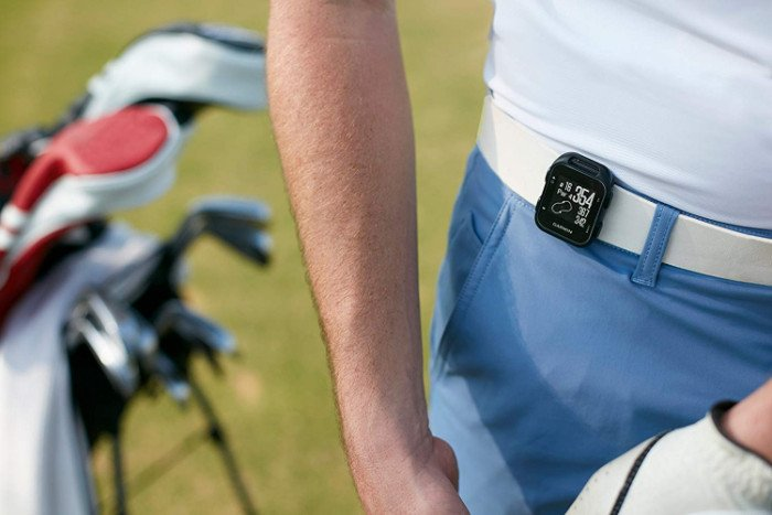Golfer With Approach G10 Attached to Belt