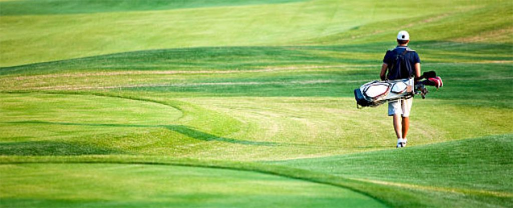 Golfer walking on golf course